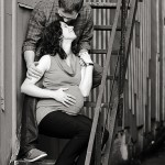 Expectant parents pose for maternity photographs in an alley way in Markham, Ontario. Shot by Hilary Beaumont of Lunaria Photography.