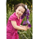 Portrait of three year old girl wearing pink in the garden. Shot in Markham Ontario by Hilary Beaumont of Lunaria Photography.