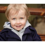 Two year old boy portrait on steps in alleyway of Markham, Ontario captured by Hilary Beamont of Lunaria Photography.